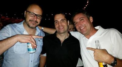 Three guys with beers out in the Hamptons.