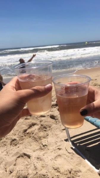 Cheers! Drinking cocktails on the beach in the Hamptons.