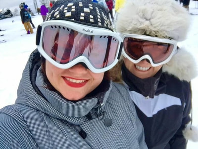 selfie on the slopes. Girls from NYC  in coats and ski masks getting ready to ski.