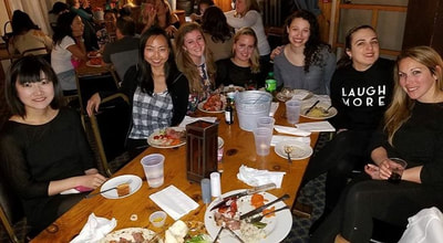 Group of friends eating dinner on their ski resort vacation to escape NYC.