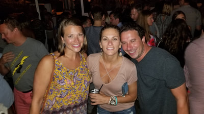 Friends enjoying the nightlife of the Hamptons during their weekend vacation.