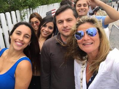A group of people pose for a selfie on their Hamptons vacation.