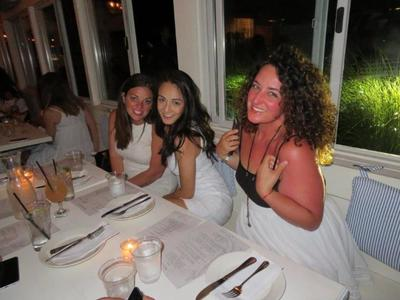 A group of girls eating at one of the finest restaurants in the Hamptons.