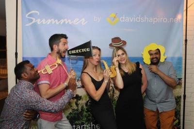 Friends pose with goofy props during their Hamptons vacation organized by  davidshapiro.net.